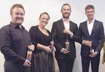 Performers for the Wagner Society in NSW AGM on 2 April 2017: (l-r) Tenor, Adam Player, Dramatic soprano, Laura Scandizzo, Baritone, Daniel Macey, and accompanist Jonathan Wilson, with wines from Brangayne Vineyards (photo, courtesy Mailis Wakeham).